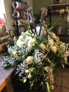 the finished floral funeral tribute with skis and poles in place